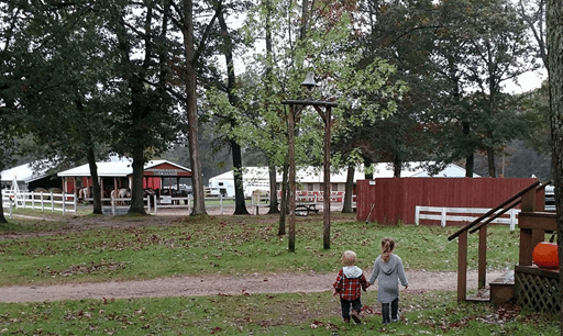 This is a photo of two young children walking around Wolf Lake Ranch.