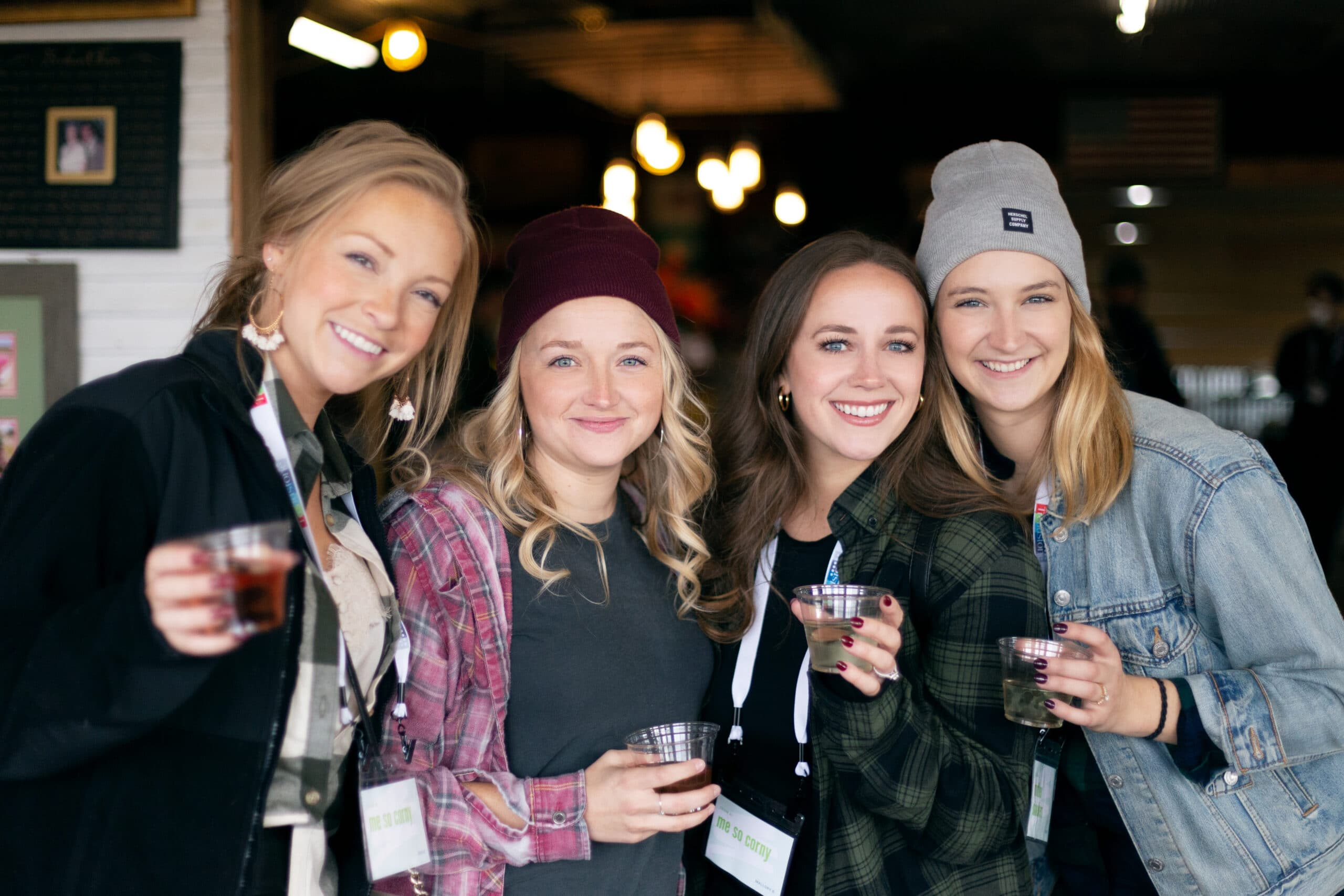 Four women drinking wine from Pink Barrel Cellars enjoying Fall activities in Grand Rapids.