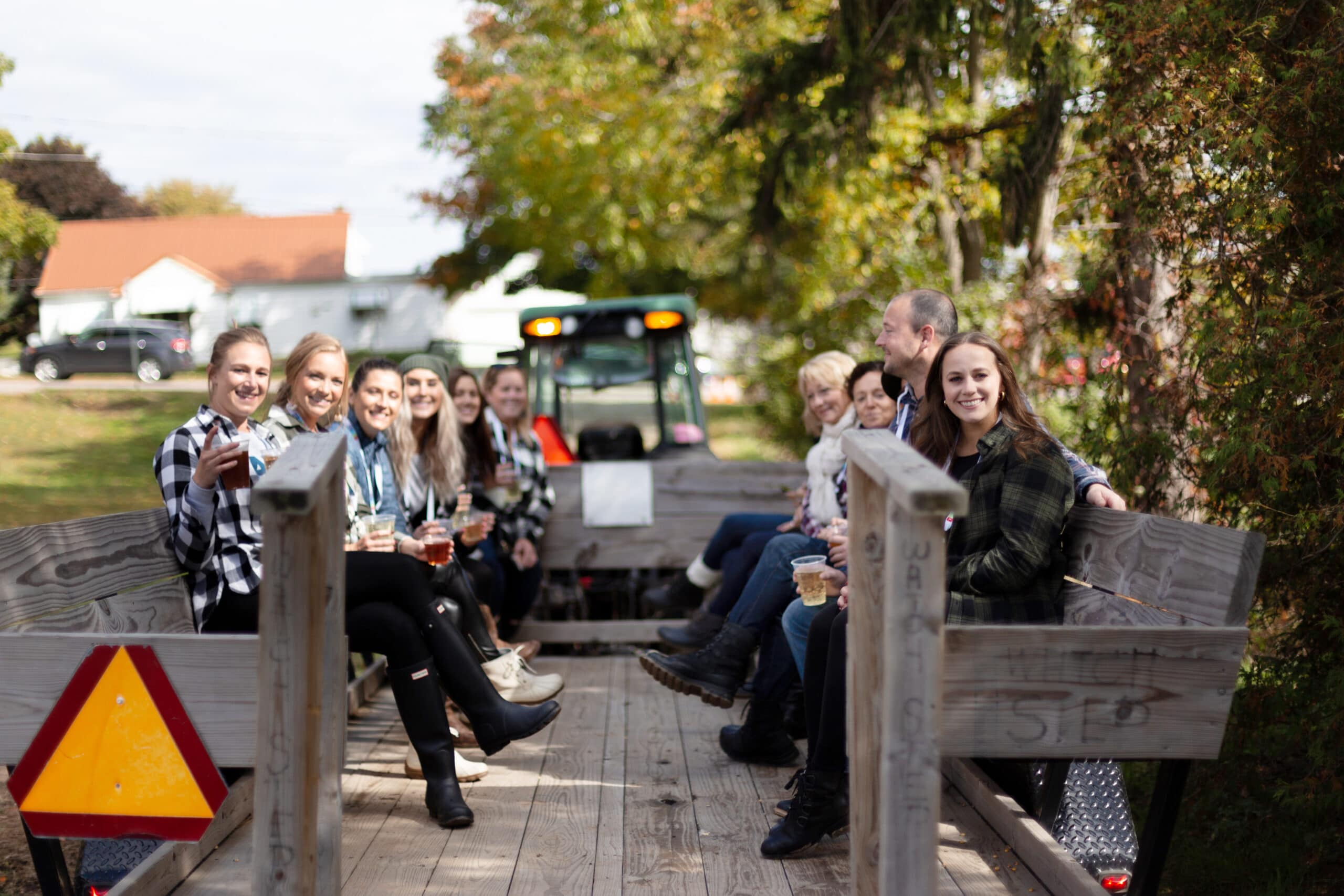 Treadstone employees enjoying a tractor ride and other Fall activities in Grand Rapids.